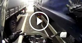 MOTORCYCLIST tries to FIT BETWEEN 2 TRUCKS! See if He Succeeds!