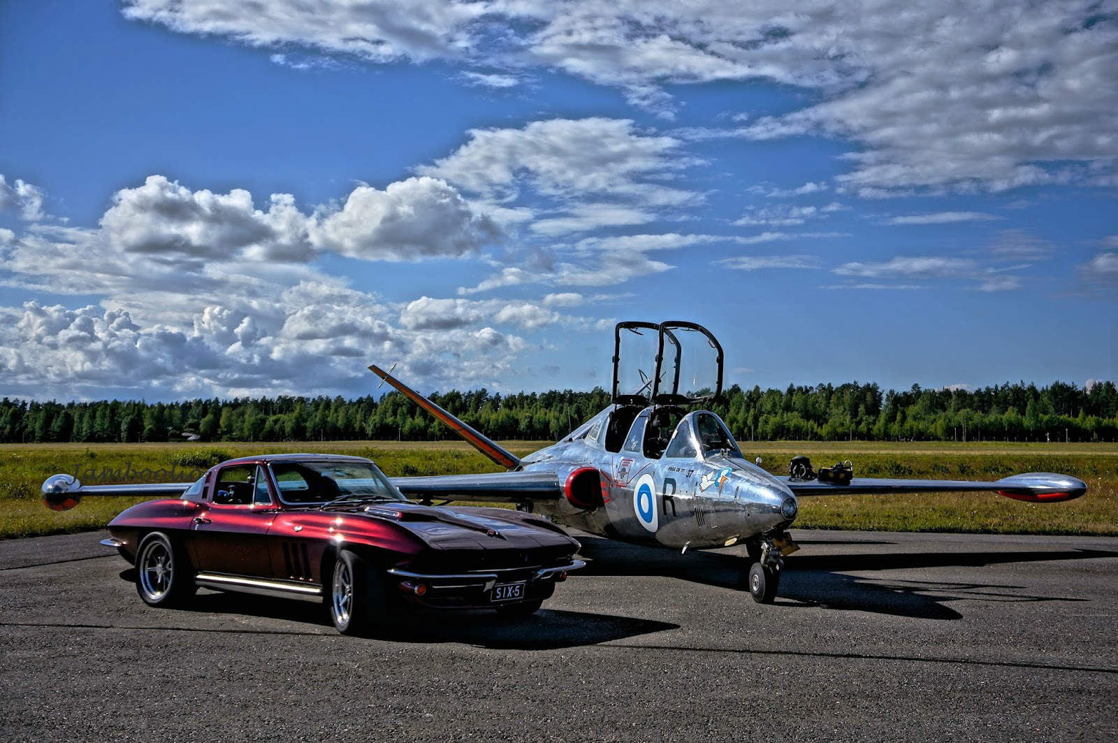 1965 Chevrolet Corvette C2 Stingray SIX-5 next to aeroplane