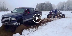 Buggy Pulls Out Mega Truck From Snow Bog