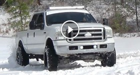 Lifted F250 Powerstroke Playing In The Snow - cl