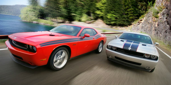 two 2010 dodge challenger cars front end in motion - cl