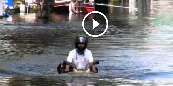 crazy honda motorcycle riding   water  thailands big flood     water cooled