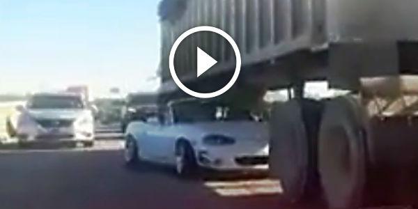 Crazy Mazda Mx 5 Miata Squeezes Under A Semi Truck Fast